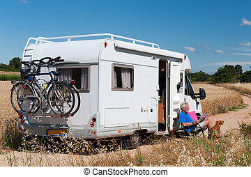Journey by mobile home - Man with dog on a trip with mobile...
