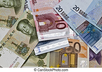 Different currency - Chines money and euro currency closeup