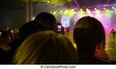 People who look concert - Panning of people who look concert...
