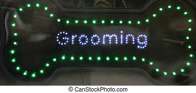 Dog grooming sign. - Dog grooming sign at a business...