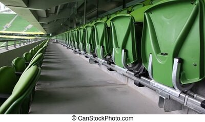 Green seats of stadium, solar day, rotating camera