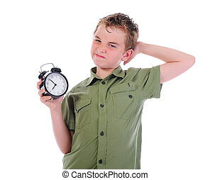 Sleepy boy with alarm-clock isolated on white background