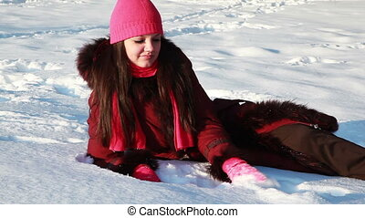 young girl sitting in snow