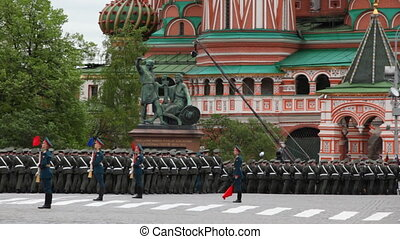 Soldiers march toward St Basils Cathedral on rehearsal of...