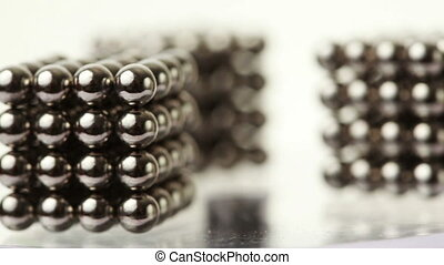 cubes made from steel balls are on rotating - three cubes...