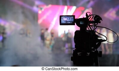 Close-up of professional camera which records concert in...