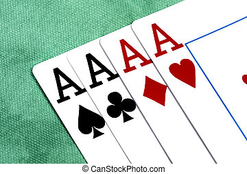 four aces - Close up view of four aces spread on a green...