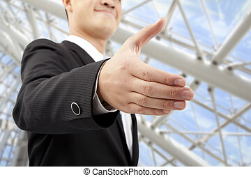 closeup of businessman's handshake in modern office