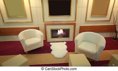 interior with fireplace, armchairs and tv set