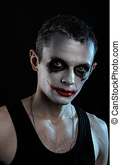 Man joker  - Spooky man joker on black background
