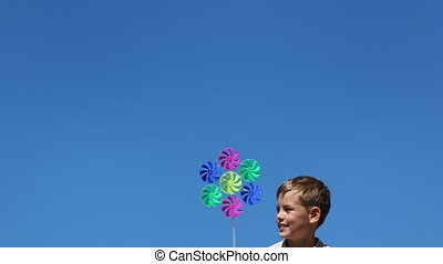 boy quickly appears in frame holding toy consisting of seven...