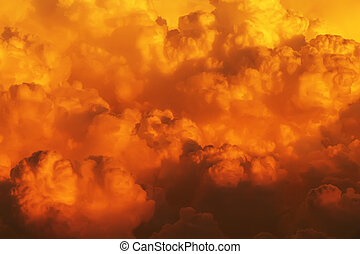 Boiling sunset clouds - view from above the clouds on a...