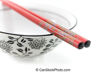 Chinese bowl with chopsticks - Close up of Chinese bowl with...