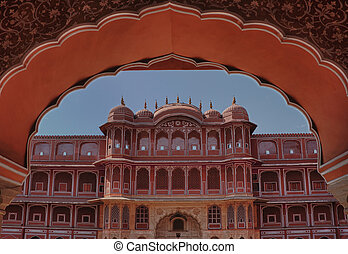 Facade of Royal palace framed under peacock arch in Jaipur...