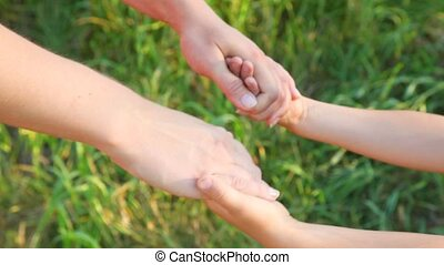 joined hands of mother and daughter - joined hands of mother...