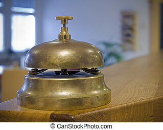 antique brass bell on counter