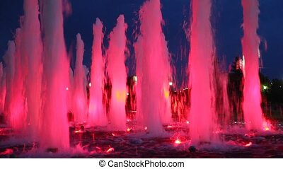 beautiful illuminated pink fountains at night