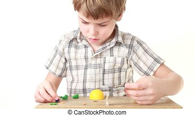 The boy try to find missed part when trying to put them...