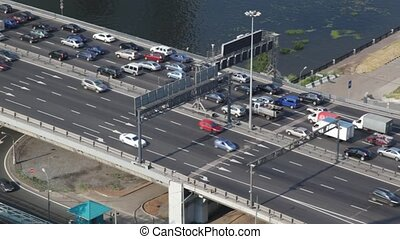 many cars moving on bridge in Moscow city, top view