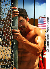 Summer portrait - Portrait of a young muscular man posing...