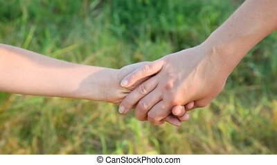 joined hands of woman and boy outdoor - joined hands of...