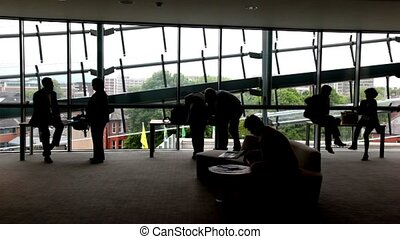 People standing near the windows - People standing near the...