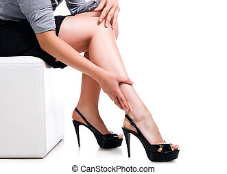 Slim long sexy woman legs on white background