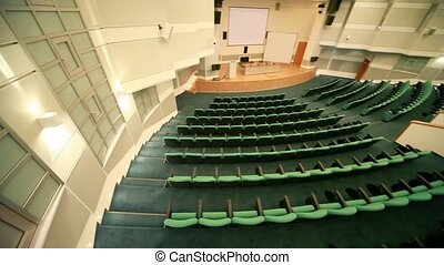 top view panning of empty conference hall with seats - top...