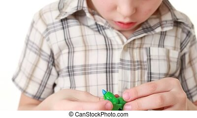 The boy trying to add toy last part but he can not