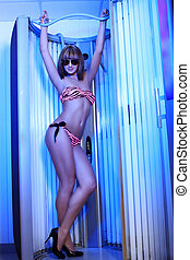 solarium - Beautiful young woman tanning in solarium Beauty,...