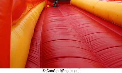 Boy drives off sitting and bouncing with inflatable rubber...