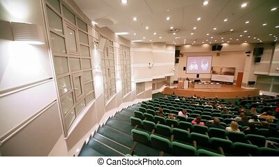 People sits in conference hall on CPM Collection Premiere