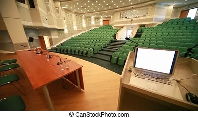view from stage of empty conference hall with seats - view...