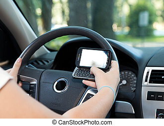 Texting and Driving - Closeup of a smart phone with a female...