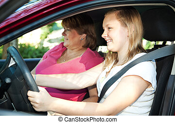 Teenage Driving Lesson - Teenage daughter gets a driving...