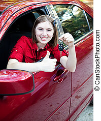 Teen Driver - Thumbs Up - Teenage girl in the car driver's...