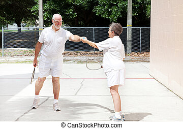 Senior Sportsmanship - Racquetball - Senior man handing the...