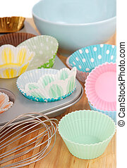 Variety of cupcake liners with wire whisk