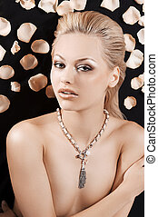 beautiful blond girl with necklace