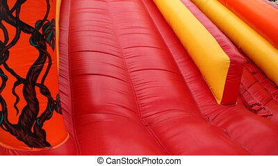 Boy drives off with inflatable rubber slides - boy drives...