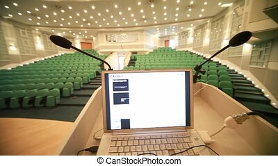 empty conference hall with green seats, panning