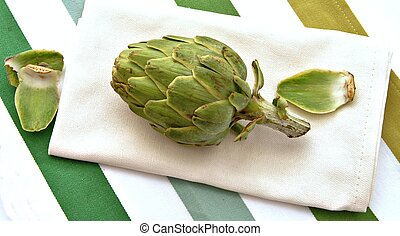 Artichoke on a napkin, on a tablecloth