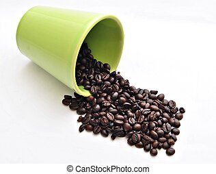 Overturned coffee cup with coffee beans isolated on white...