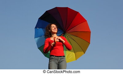 Woman on shoulder rotates umbrella - pretty young woman on...