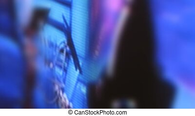 Closed-up view on TV while it is turned on, time lapse