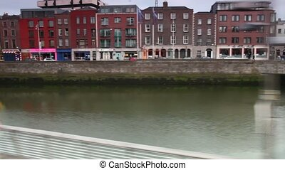 Moving along the river Liffey, Ha'penny Bridge , cars and...