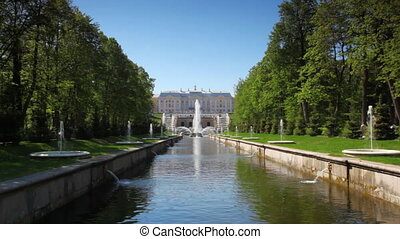 Grand Palace and Sea Channel in Peterhof at St. Petersburg...