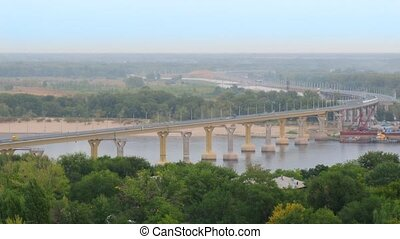 View on bridge across Volga River with moderate vehicle...