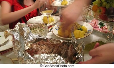 View on piece of roasted meat on table at banquet - View on...