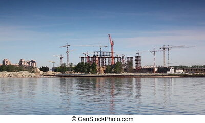 Building with lot of tower cranes on Peter Island in St...